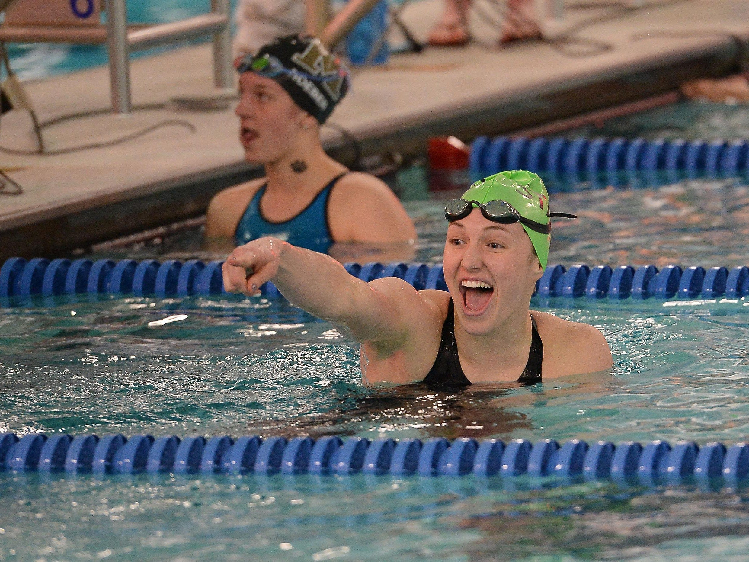 Bailey Kovac reacts after winning the 100 yard breaststroke event at the CHSAA State Swimming Championships at Edora Pool Ice Center in February.