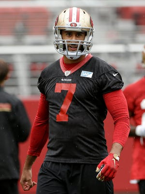 San Francisco 49ers quarterback Colin Kaepernick waits for drill during an NFL football mini-camp in Santa Clara, Calif., Wednesday, June 10, 2015. Kaepernick will not attend the A4 camp in Ann Arbor as originally planed.