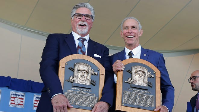 Former Tigers Jack Morris, left, and Alan Trammell pose for a photograph with their plaques during the Baseball Hall of Fame induction ceremony.