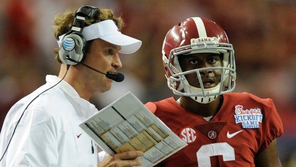 Alabama offensive coordinator Lane Kiffin talks with