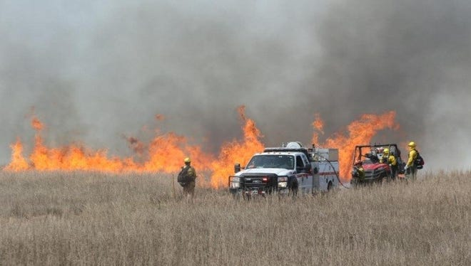 In a two-day operation, more than 2,000 acres of grass were burned at the northern end of Padre Island National Seashore.