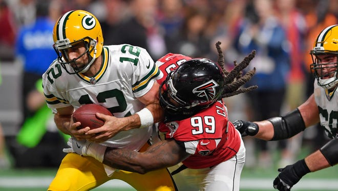 Packers quarterback Aaron Rodgers is sacked by Falcons defensive end Adrian Clayborn during the second half Sunday at Mercedes-Benz Stadium.