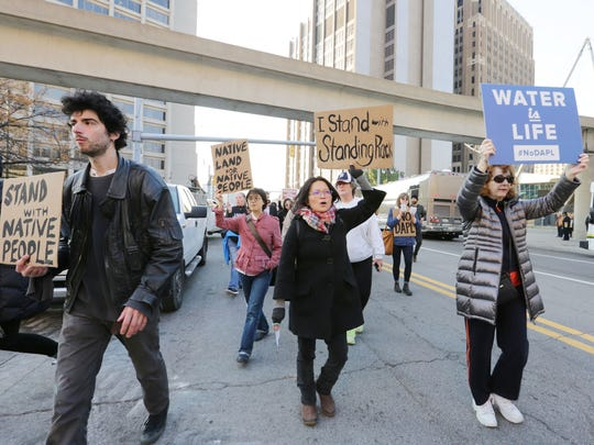 Protesters march down Michigan Ave from the McNamara Federal Building to Campus Martius  in downtown Detroit as they take part in a nationwide day of action against the Dakota Access Pipeline Tuesday, Nov. 15, 2016.