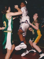 Tamika Catchings (center) recorded a quintuple-double while playing at Duncanville High in Texas.