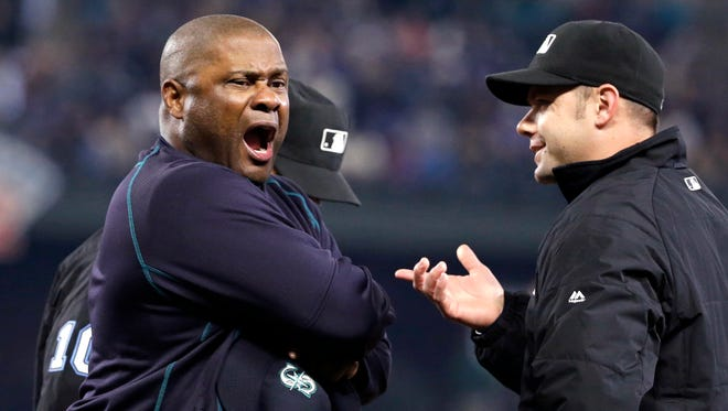 Seattle Mariners manager Lloyd McClendon, left, yells as he talks with umpire Will Little after being ejected from the baseball game against the New York Yankees during the third inning Tuesday, June 2, 2015, in Seattle.