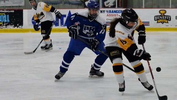Lakeland/Panas/Hen Hud forward Paige Sullivan (right)