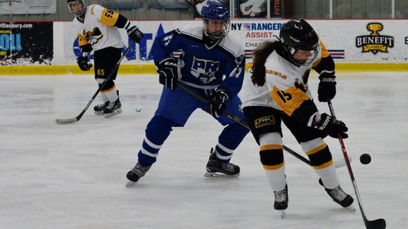 Lakeland/Panas/Hen Hud forward Paige Sullivan (right)