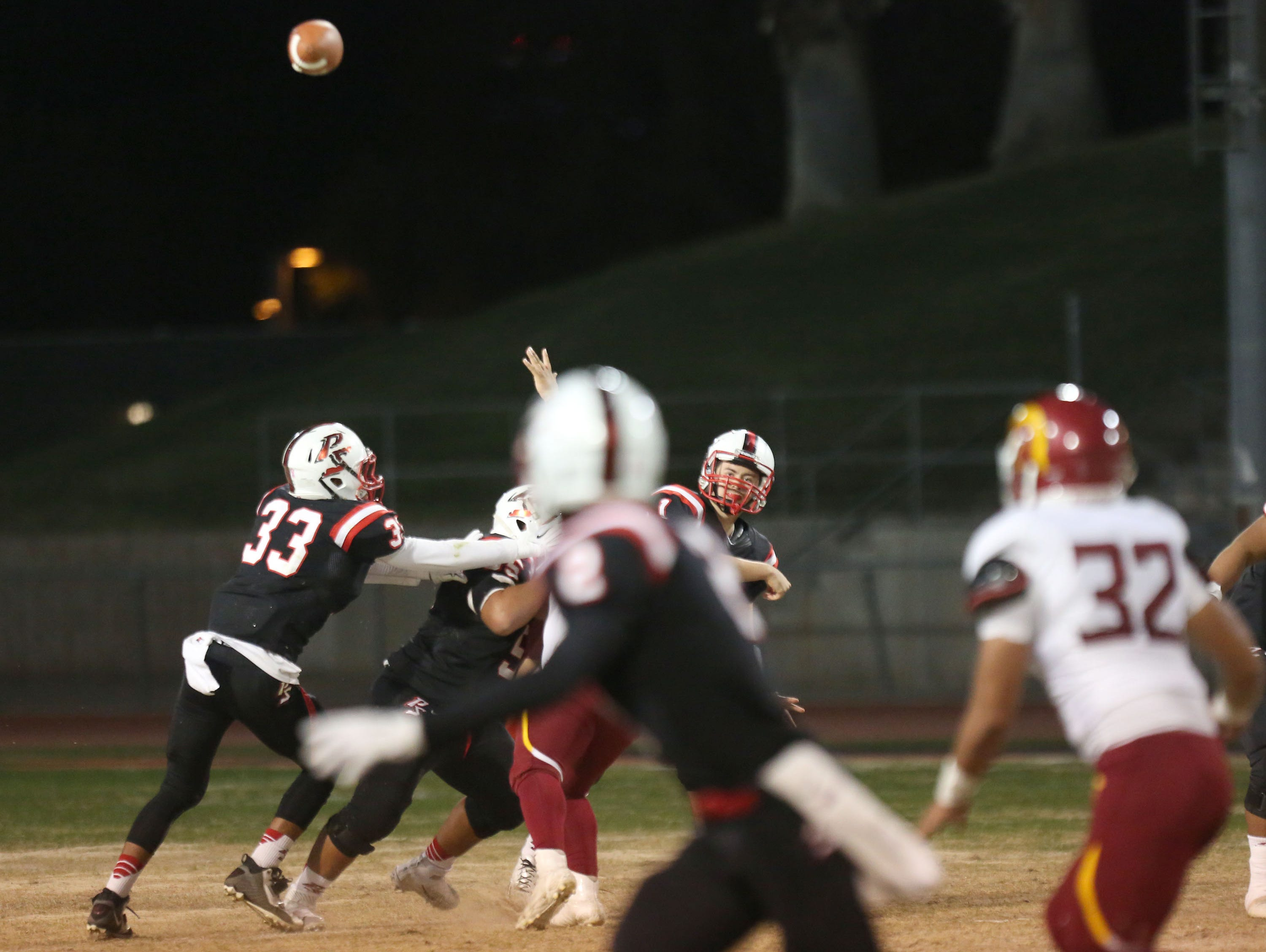 Quarterback Will Olvera throws one of his six touchdown passes during the Indians win Friday, November 13, 2015.
