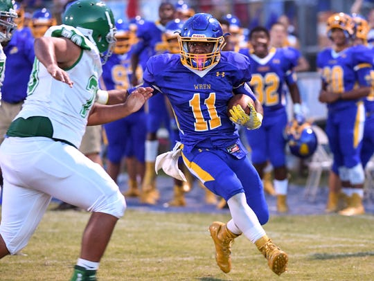 Wren senior Tyrese Franklin (11) runs by an Easley