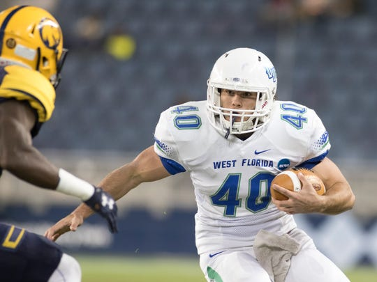 Chris Schwarz (40) runs during the University of West Florida vs Texas A&M - Commerce NCAA Division II National Championship football game at Children's Mercy Park in Kansas City, Kansas on Saturday, December 16, 2017.