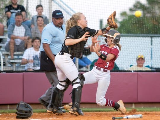 Shelby McLean (3) slides into home ahead of the throw