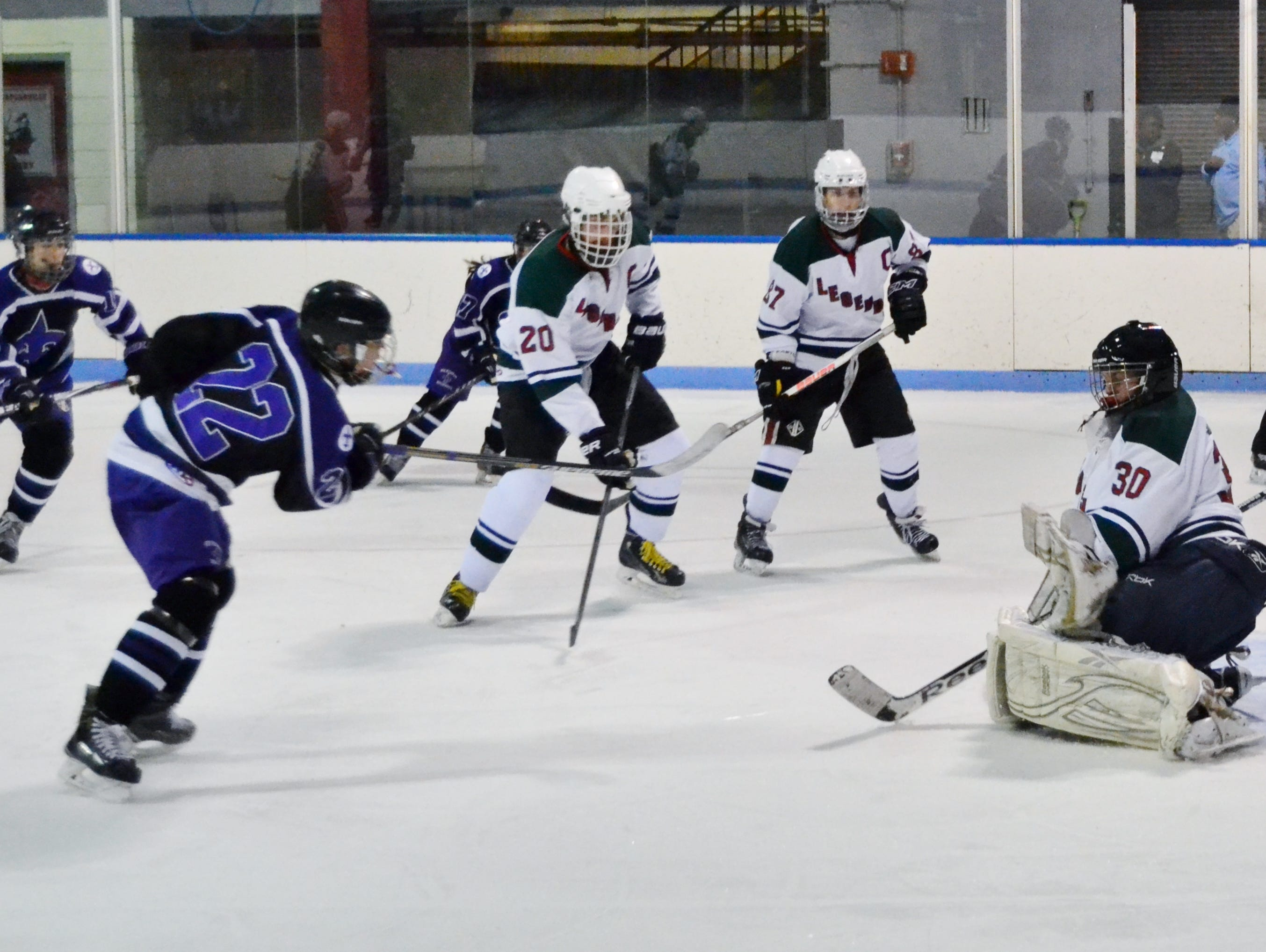 Rivertown goalie Sean Gonder makes a third-period glove save after Steven Kroleski comes in clean during a 4-1 Legends win at Playland.