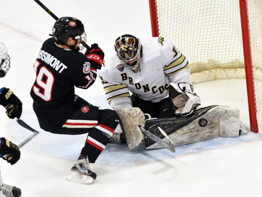 St. Cloud State's Mikey Eyssimont (19) tries to get to a loose puck against Western Michigan goalie Trevor Gorsuch on Saturday at Lawson Ice Arena in Kalamazoo, Michigan. Eyssimont had a goal and two assists in the 5-5 tie.