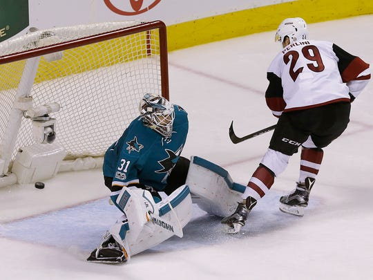 Coyotes left wing Brendan Perlini (29) scores a shootout goal past San Jose Sharks goalie Martin Jones (31) in Saturday's Arizona win.