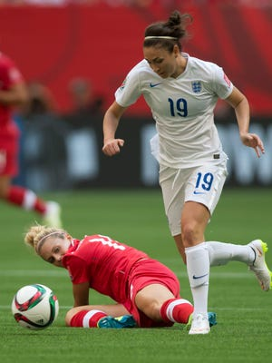 England's Jodie Taylor chases down the ball in match against Canada on Saturday in quarterfinals.
