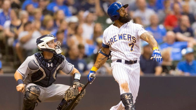 Eric Thames watches his game-winning home run during the 10th inning Friday against the Padres at Miller Park. The Brewers won, 6-5.