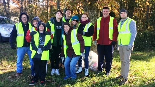Members of the newly chartered Rotary Club of Tri-County along with some Interact members conducted a cleanup mission along Oak Road on Nov. 11.