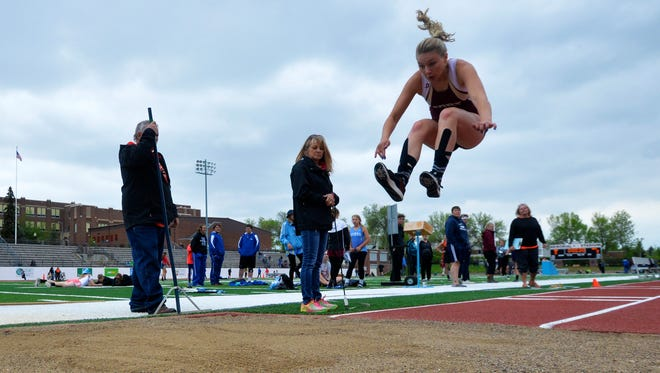 Fort Benton's Nicole Axtman competes in the triple jump during the Ralph Halverson Northern C Divisional Track Meet, Thursday at Memorial Stadium.