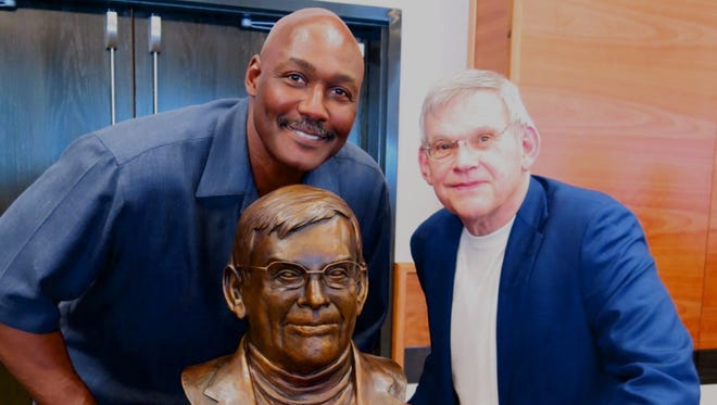 Karl Malone and Dr. Billy Bundrick with bronze bust of Bundrick at Louisiana Tech reception.