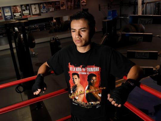 Boxer Ricardo Lucio-Galvan, 20, poses for a photo at