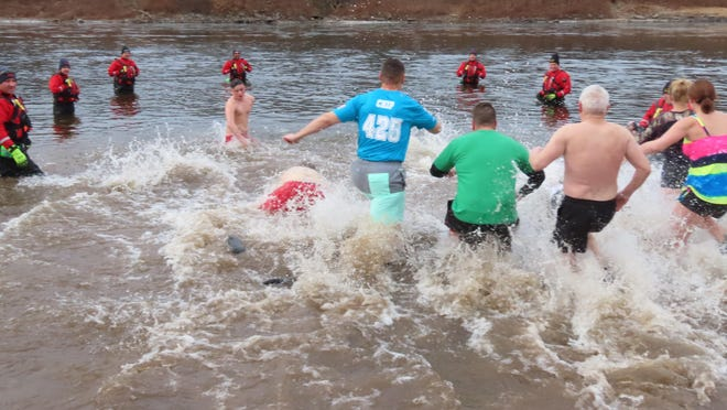 Last January, seven members of the Port Jervis Fire Department's Water Operations Team - Mike Aumick, Keith Brown, Tyler Kowinsky, Bryce Sotelo, Dana Presto, Justin Brewster, and Petey Fuller - were stationed in the water as 61 people took part in Port's first Polar Plunge.