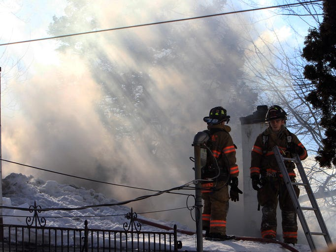 Mahopac and Mahopac Falls firefighters work the scene of a house fire on East Lake Blvd. in Mahopac Feb. 26, 2014. A Mahopac firefighter was injured and transported to Putnam Hospital Center.