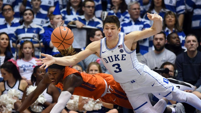 Duke's Grayson Allen and Virginia Tech's Chris Clarke battle for a loose ball during their game last week.