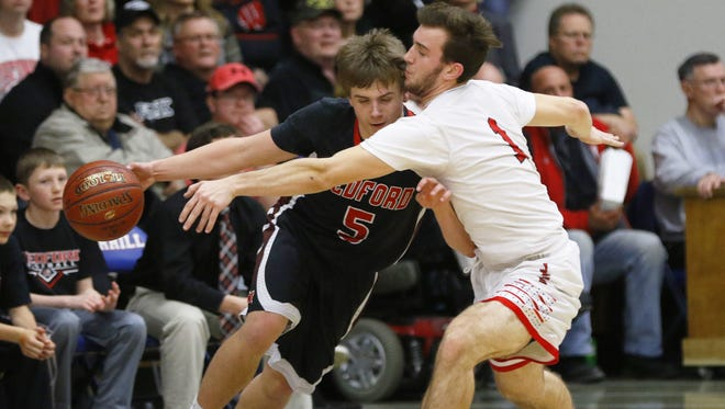 Cameron Wenzel (left) was a unanimous first-team selection after averaging 20.1 points per game for Medford.