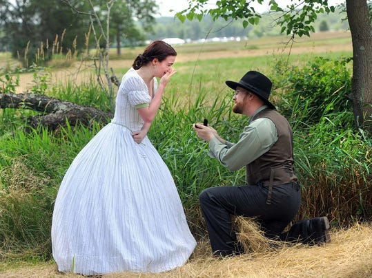 Re-enactor Patrick McCarthy gets down on one knee to propose to his girlfriend Anna Jennings at the Gettysburg 150th celebration on Thursday, July 4, 2013. The seamstress said yes to her boyfriend of four years after he surprised her with the gesture. YORK DAILY RECORD/SUNDAY NEWS--JASON PLOTKIN