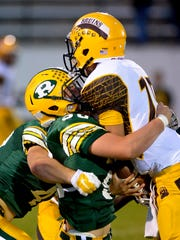 CMR's Payton Sexe wraps up Helena Capital quarterback Gus Chancy in the backfield during a game in 2014 at Memorial Stadium.