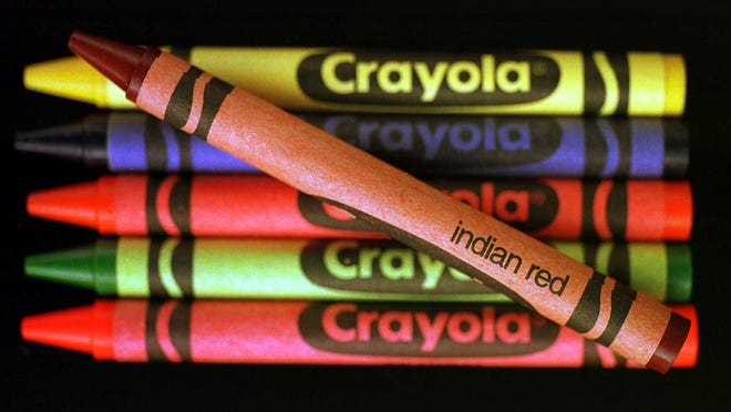 An indian red Crayola crayon is displayed with other Crayolas Tuesday, March 9, 1999, in Philadelphia.  Burnt sienna is for coloring houses and trees. Brick red is for fireplaces. Goldenrod is the sun. And indian red? ``To color Indians,'' said one 7-year-old. Crayola has decided to end such youthful misunderstandings by changing the name of the reddish-brown crayon. (AP Photo/Dan Loh)