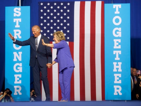 Democratic presidential nominee Hillary Clinton and Vice President Joe Biden acknowledge the crowd at Riverfront Sports athletic facility on August 15, 2016 in Scranton, Pennsylvania.