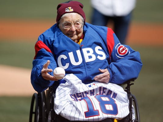 Loyola University Chicago's Sister Jean throws out a ceremonial pitch prior to the start of the Cubs' home opening baseball game against the Pittsburgh Pirates Tuesday, April 10, 2018, in Chicago. (AP Photo/Jim Young)