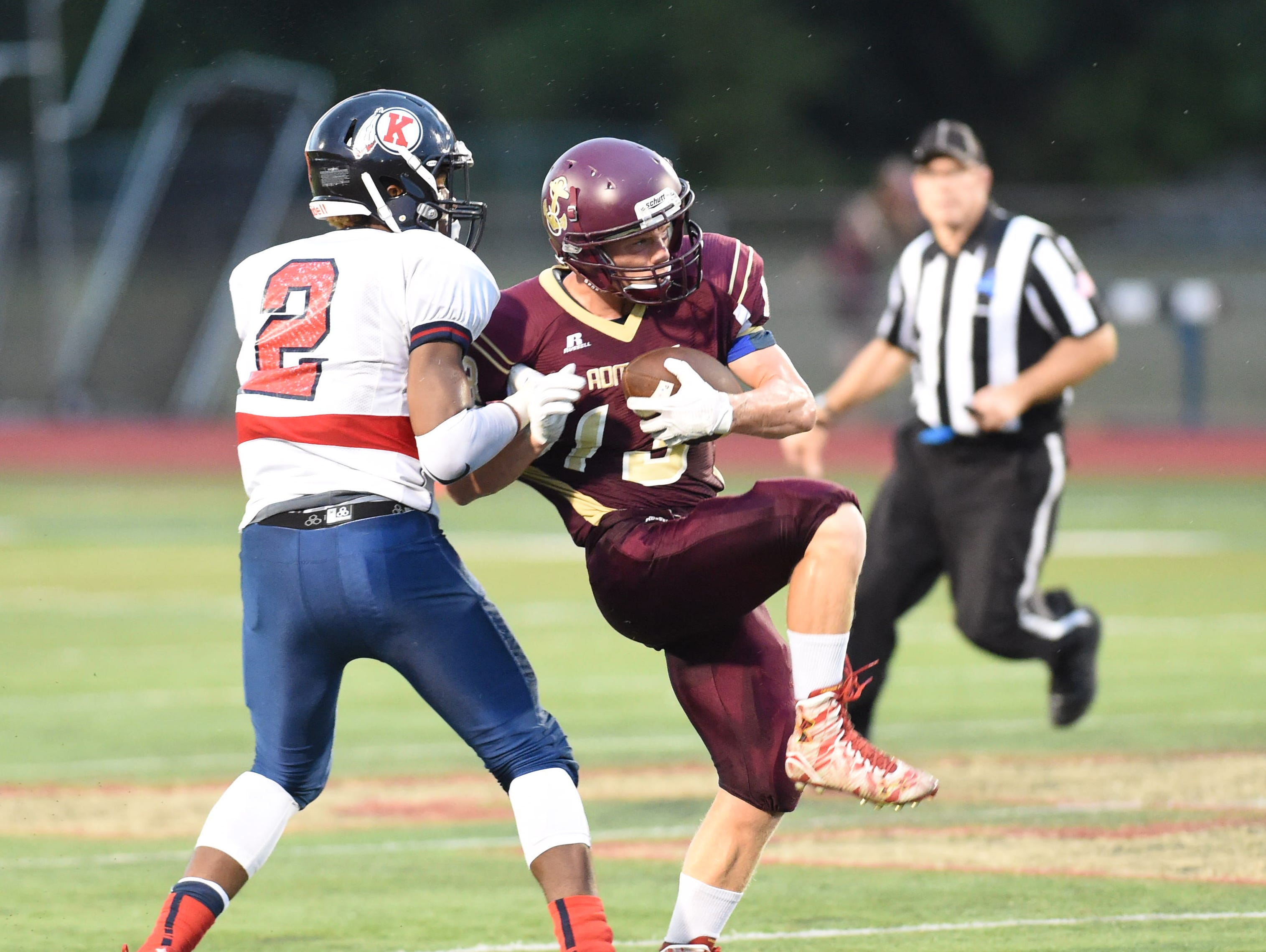 Arlington's Jacob Pfeifer intercepts a pass intended for Ketcham's Zaahir Woody during Friday's game in Freedom Plains.