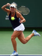 Alexandra Sanford returns the ball to Ellie Douglas on Sunday, April 10, 2016, during the Asics Easter Bowl championship game at the Indian Wells Tennis Garden in Indian Wells, Calif. Sanford won in three sets 6-4, 1-6, 6-1.