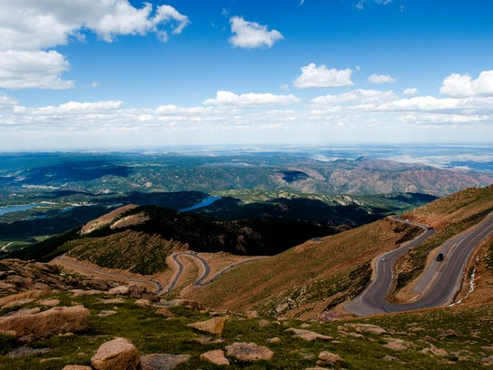 Visitors explore the sites near Pikes Peak Highway