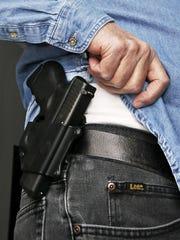 A gun on a hip.