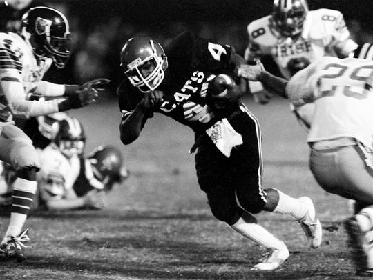 Overton High School running back Keith Davis (43) attempts