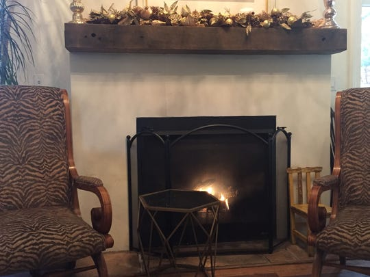 One of the coziest spots at BrewHaHa in Greenville is on the couch in front of the fireplace.