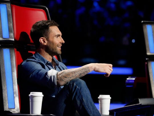 Adam Levine looks over his team at the Live Playoffs