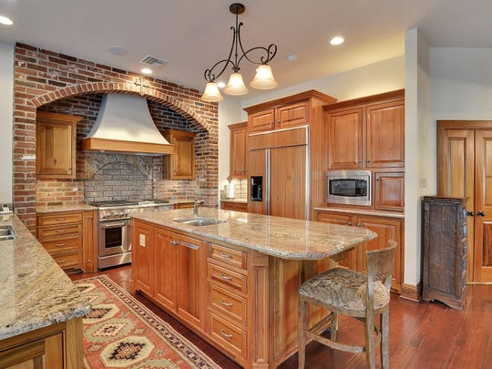 A kicthen to die for with slab marble granite, fine wood cabinets and top of the line appliances.