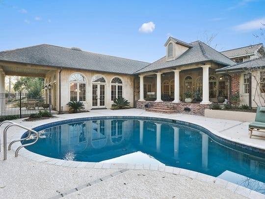 Amazing pool in back of the home overlooks the Vermilion River.