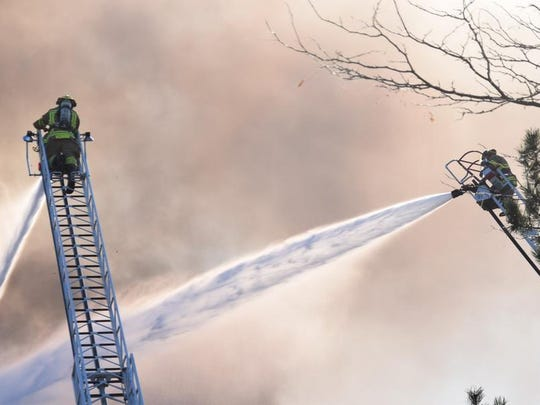 It took firefighters nearly five hours to get a condo blaze under control in Bloomfield Hills. Nobody was injured and a family cat was rescued.