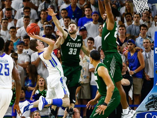 Stetson University's Luke Doyle attempts to block FGCU's Christian Terrell during the Atlantic Sun Basketball Championship game at Alico Arena on Sunday, March 6, 2016. (Scott McIntyre/Staff)