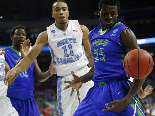 North Carolina forward Isaiah Hicks (4), Florida Gulf Coast forward Antravious Simmons (32), North Carolina forward Brice Johnson (11) and Florida Gulf Coast forward Marc Eddy Norelia (25) watch as an FGCU possession goes out of bounds during the first half Thursday, March 16, 2016 of a first-round men's college basketball game in the NCAA Tournament, Thursday, March 17, 2016, in Raleigh, N.C. (Corey Perrine/Staff)