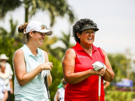 Nancy Lopez, Palm City, FL, and Ally McDonald, Fulton, Miss, share a laugh before heading out on the course for the day. 2016 Chico's Patty Berg Memorial Round 3 Saturday, April 16, 2016 at Cypress Lake Country Club.
