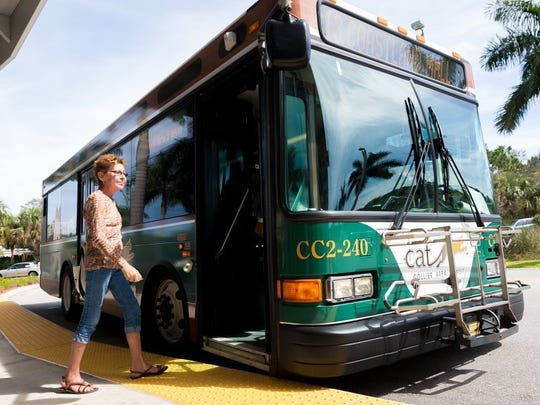 Naples resident Suzanne Listo boards a Collier Area Transit bus heading from the Intermodal Transfer Station at the Collier County Government Center on Tuesday, Feb. 16, 2016, in East Naples. The Collier County bus service celebrated its 15th anniversary on Friday. (David Albers/Staff)