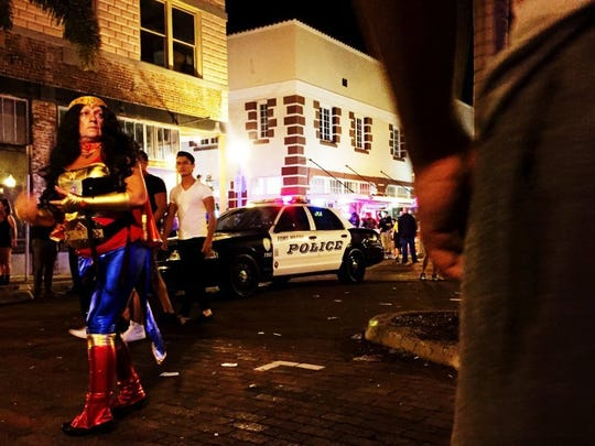 Attendees are cleared off Hendry Street by Fort Myers police officers in downtown Fort Myers following a shooting at ZombiCon that killed one and injured five on Saturday, Oct. 17, 2015. (Carolina Hidalgo/Staff)
