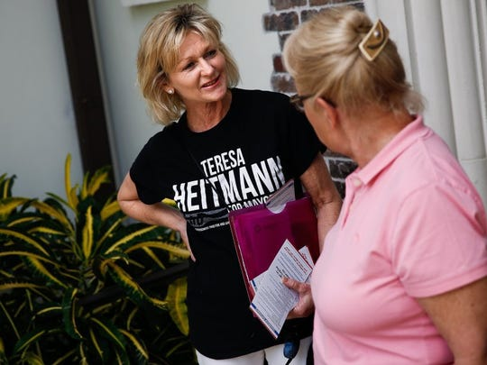 Naples City Councilwoman and mayoral candidate Teresa Heitmann, left, chats with Signe Heybroek while Heitmann and some of her campaign committee walk the Royal Harbor neighborhood talking to neighbors about their vote for Naples mayor on Sunday, February 28, 2016. (Scott McIntyre/Staff)