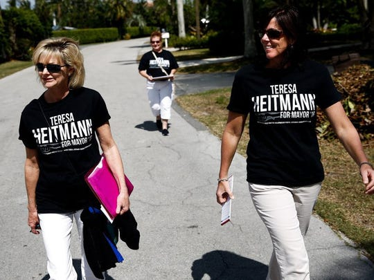 Naples City Councilwoman and mayoral candidate Teresa Heitmann walks through the Royal Harbor neighborhood along with Stephanie Zaiser, right, and Colleen Greenling talking to neighbors about their vote for Naples mayor on Sunday, February 28, 2016. (Scott McIntyre/Staff)